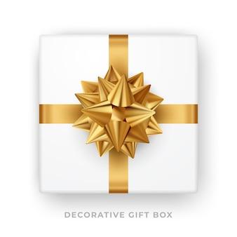 金色の弓とリボンが分離された白いギフトボックス。上面図。図