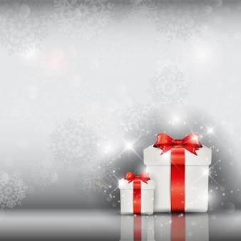 Bokeh은 크리스마스 배경에 흰색 선물