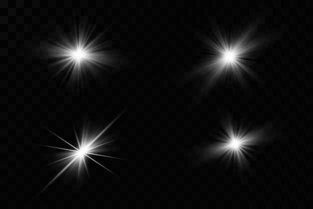 透明な背景に白い輝く光が爆発します。きらめく魔法のダスト粒子。輝く星。透明な太陽、明るいフラッシュ。きらめき。明るいフラッシュを中央に配置します。