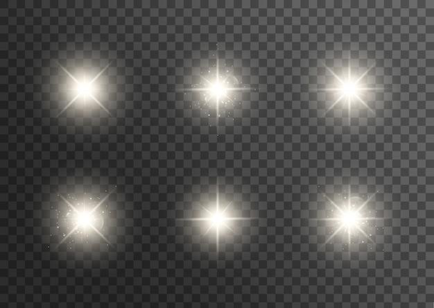 투명한 흰색 빛이 폭발합니다. 반짝이는 마법의 먼지 입자. 밝은 별. .