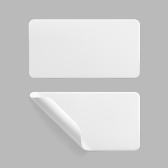 White glued rectangle stickers with curled corners mock up set. blank white adhesive paper or plastic sticker label with wrinkled and creased effect. template label tags close up. 3d realistic vector.