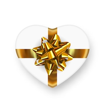 White heart shape gift box with shiny golden bow and realistic falling shadow.