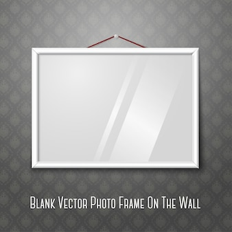 White horizontal photo frame hanging on the wall.