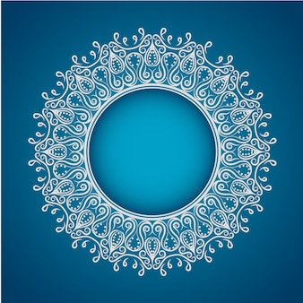 White mandala on blue background