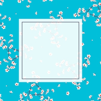 White momo peach flower frame on indigo blue background