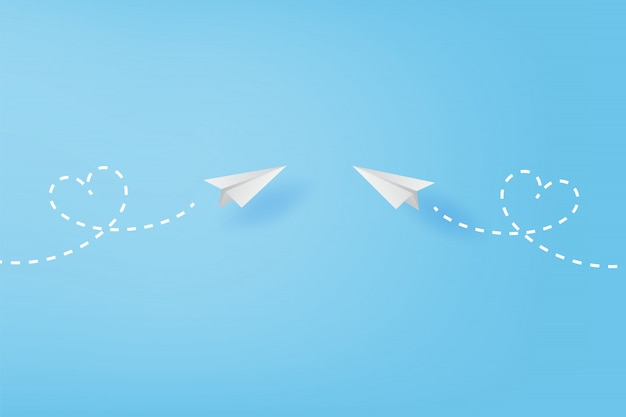 White paper airplanes flying heart concept