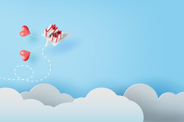 White paper airplanes with gift flying on sky