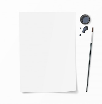 White paper document whith brush pen, inkwell and ink drops on desk. top view mockup for hand drawn design.