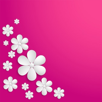 White paper flowers on pink background.