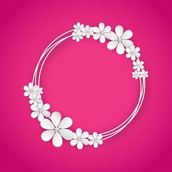 White paper flowers on pink color background.