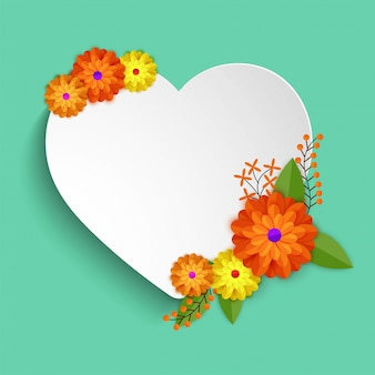 White paper heart decorated with colorful flowers.