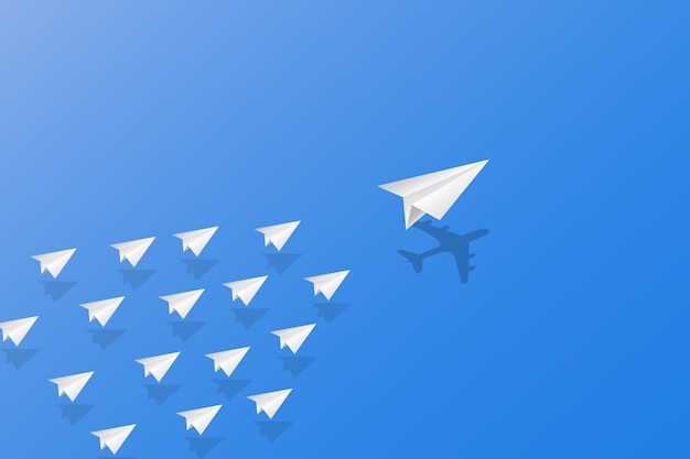 White paper planes with shadow flying on sky