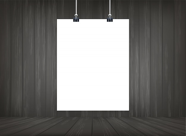 白い紙ポスターは、木製の部屋のスペースの背景にぶら下がっています。