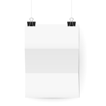 White paper sheet hanging on paper clips on white