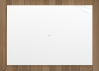 White paper sheet on wood texture background.