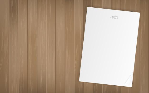 木の質感の背景に白い紙シート