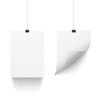 White paper sheets hanging on paper clips isolated