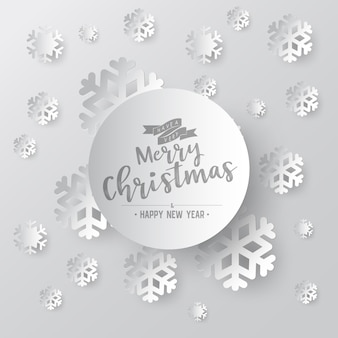 White paper snowflake on white ornate background with merry christmas phase text