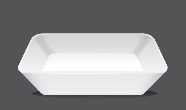 Белая плоская тарелка на черном фоне