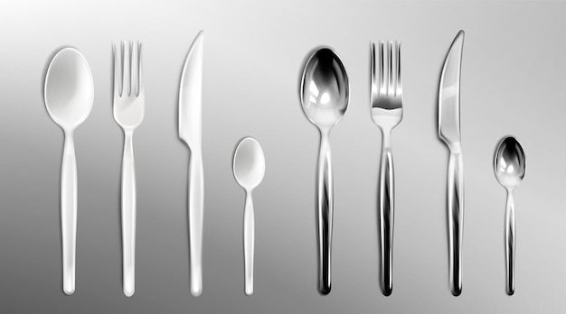 White plastic and steel cutlery on transparent