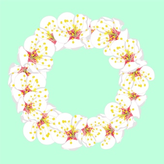 White plum blossom flower wreath on green mint