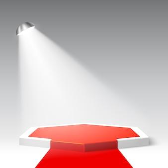 レッドカーペットと白い表彰台。ペデスタル。六角形のシーンとスポットライト。図。