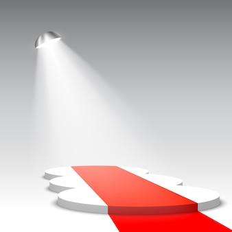 レッドカーペットと白い表彰台。ペデスタル。スポットライトのあるシーン。図。