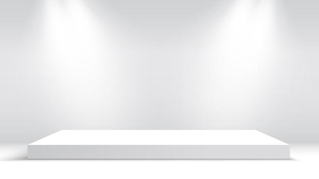 Белый подиум с точечными светильниками. пьедестал.