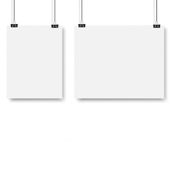 White poster hanging with binder