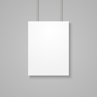 White poster mockup on grey wall