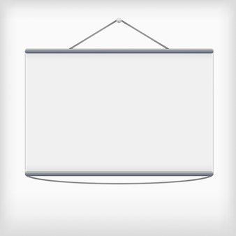 White projection screen hanging from wall