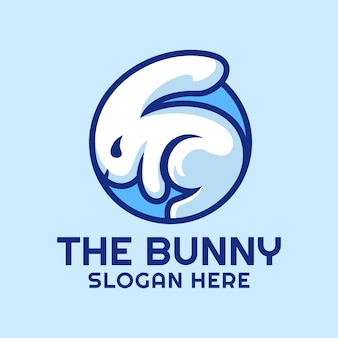 円のロゴの白いウサギ Premiumベクター