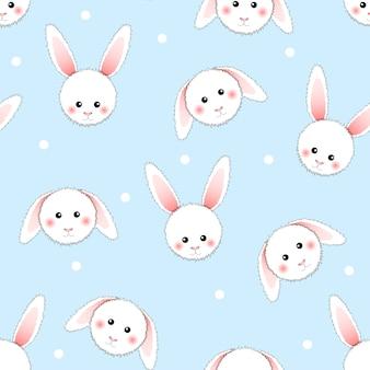 Белый кролик на светло-голубом фоне.