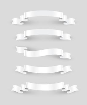 White ribbons set isolated on gray background.