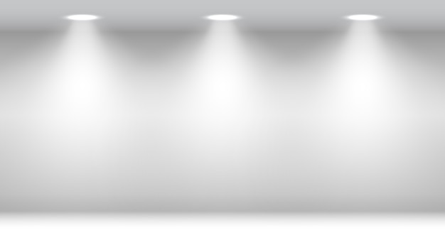 スポットライトのある白い部屋。空白のスタジオ。