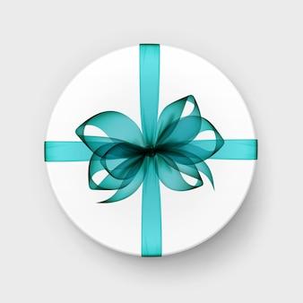 Белая круглая коробка с синим бантом и лентой