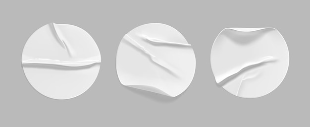 White round crumpled sticker mock up set. adhesive white paper or plastic sticker label with glued, wrinkled effect on gray background. blank templates of a label or price tags. 3d realistic vector.