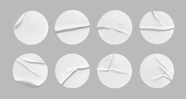 White round crumpled sticker set. adhesive white paper or plastic sticker label with glued, wrinkled effect on gray background. blank templates of a label or price tags. 3d realistic.