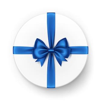 Белая круглая подарочная коробка с блестящим синим атласным бантом и лентой