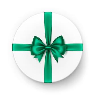 Белая круглая подарочная коробка с блестящим ярко-зеленым изумрудным атласным бантом и лентой