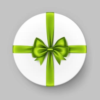 光沢のあるグリーンライムサテンの弓とリボンが付いた白い円形のギフトボックス