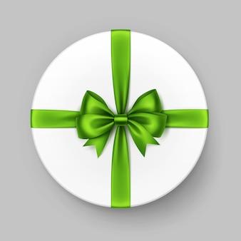 光沢のある緑のサテンの弓とリボンが付いた白い円形のギフトボックス