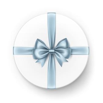 Белая круглая подарочная коробка с блестящим голубым атласным бантом и лентой