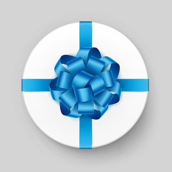 White round gift box with shiny light blue turquoise azure  bow and ribbon top view close up  on background