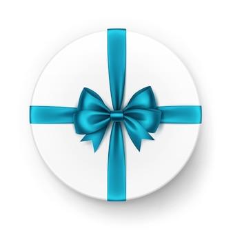 Белая круглая подарочная коробка с блестящим светло-голубым бирюзовым атласным бантом и лентой