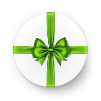Белая круглая подарочная коробка с блестящим светло-зеленым атласным бантом и лентой