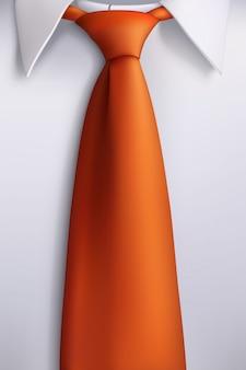 白いシャツのオレンジ色のネクタイ
