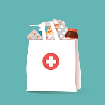 White shopping bag with different medicaments. pharmacy store.