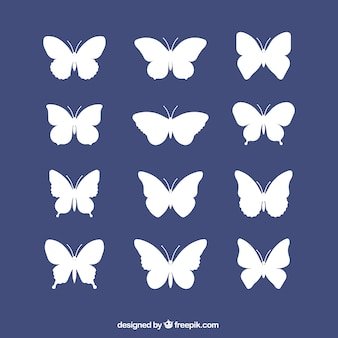 White silhouettes set of butterflies