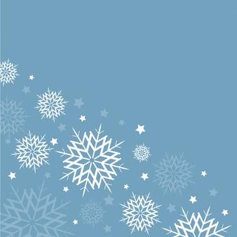 ライトブルーの背景に白い雪片